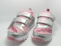 The girl sports shoes