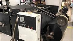 Garbage bag making machine with draw tape