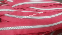 5# nylon zipper with man pattern si  er teeth and transparent thread suture