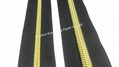 10# man pattern nylon zipper with black tape and golden teeth
