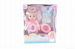 14 inch long doll with I