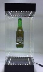 magnetic floating rotating levitation bottle earphone jewerly display platform