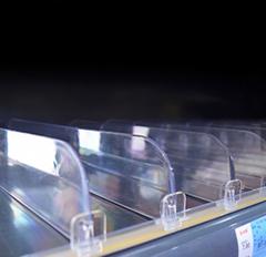 Adjustable shelf divider for supermarket retail display