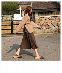 The new women's sweater skirt in autumn and winter features a long high waist an