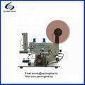 Semi automatic top labeling machine