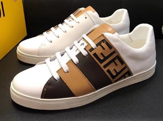 Fendi Mania low-top leather sneaker with colorblock FF detail. Round toe. Lace-up front. Logo-embossed tongue. Polyester lining. Rubber sole. Made in Italy.