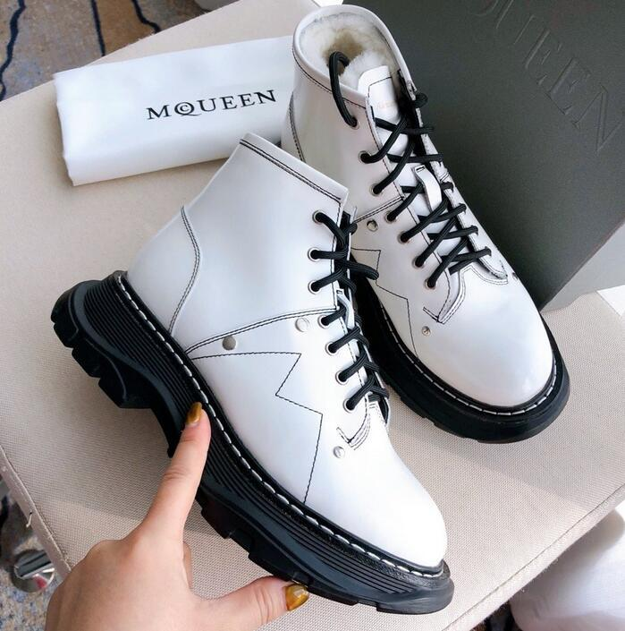 ALEXANDER MCQUEEN Lace-Up Lug Sole Hiker Boot trekking across the concrete jungle.