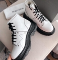 ALEXANDER MCQUEEN Lace-Up Lug Sole Hiker Boot trekking across the concrete jungl