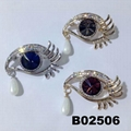 fashion women crystal stone eye brooch