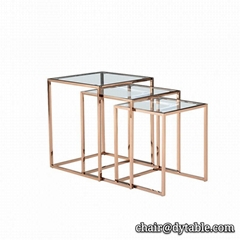 Modern glass top polished stainless steel base coffee table gold