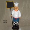 Chef Holding Menu Board And Tray Doorman