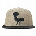 Custom hemp snapback featuring black embroidered afro rooster Trucker Hat