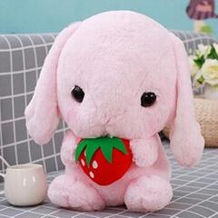 Plush toy holding strawberry rabbit