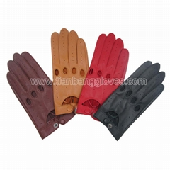 Perforated leather driving glove with knuckle holes and snap closure at wrist