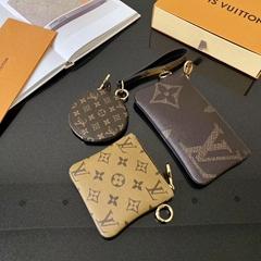 Trio Pouch M68756 Monogram wristlet    Circle zips purse wallet