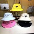 PRADA Triangle Logo Bucket Hat in Nylon for women