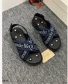 Alexander McQueen Cross Strap Sandals Men black leather sandals