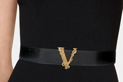 House's iconic Virtus hardware in gold-tone adorns the buckle belt