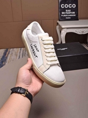 SAINT LAURENT Court Classic distressed logo embroidered canvas and leather shoes