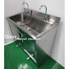 Stainless steel hand washing sink in hospital operating room