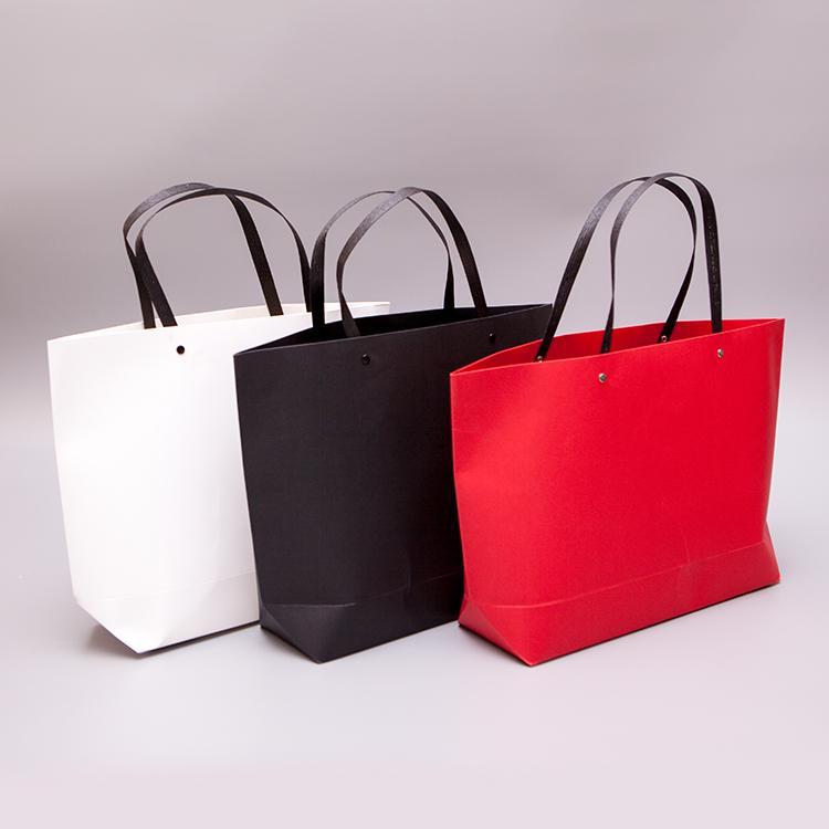 厂家直销加厚款纸袋定做服装店手提袋通用款礼品袋订制现货批发 3