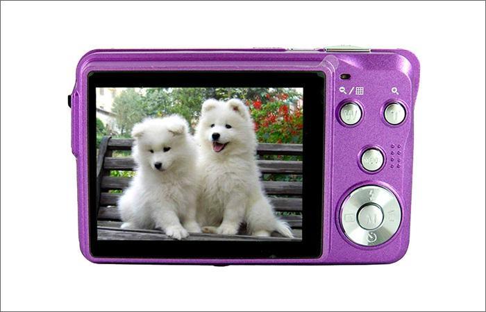 15mp digital camera with 2.7'' TFTdisplay 4x digital zoom 3 x optical zoom  9