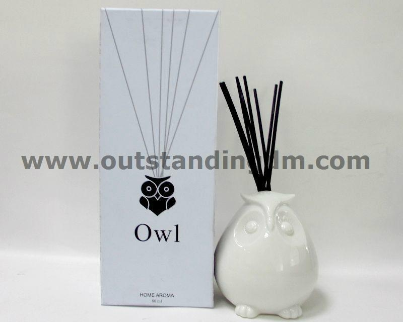 reed diffuser in ceramic owl holder and rattan sticks