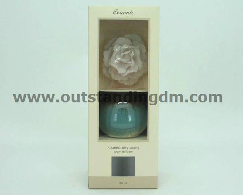 white ceramic flower with glass bottle