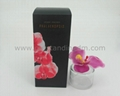 artificial flower with cotton stick in glass bottle with nice packing