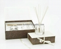glass bottle with stopper and ribbon and rattan sticks