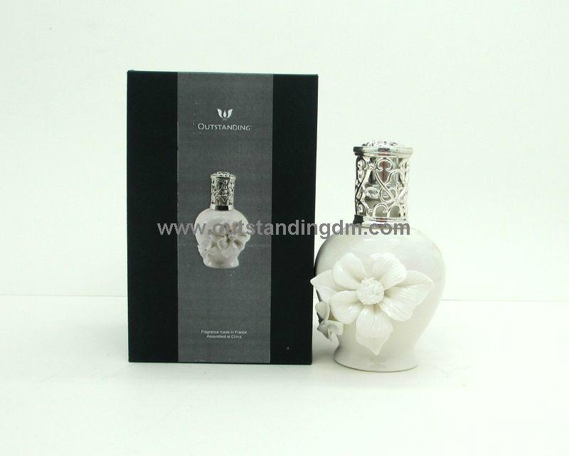 white ceramic bottle with decorative flower for aroma lamp