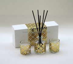 clear glass bottle wrapped with gold  laser cut paper and rattan sticks
