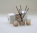 reed diffuser  in glass bottle with wrapped with rose gold  laser cut paper