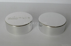 Anodized aluminum cap