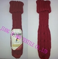 Knitted wine bottle cover with leather logo
