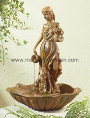 woman holds a bushel of wheat resin fountain