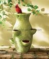 cardinal sits atop pocketed pot, garden planter