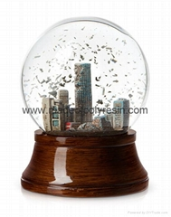 Souvenir snow globe with wooden  color base