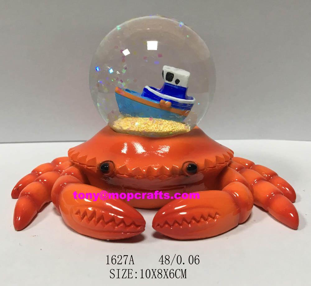 Polyresin crab with tourist snow ball