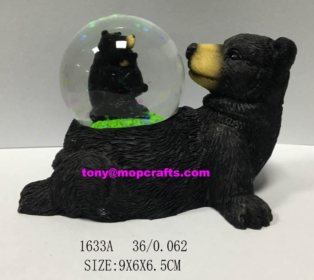 Polyresin black bear with snow globe