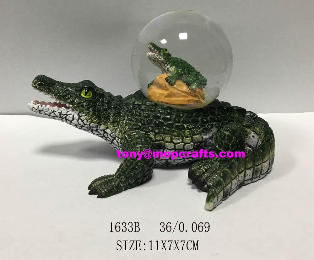 Resin crocodile snow globe in good shape 1
