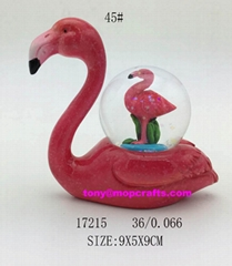 polyresin flamingo with snow globe