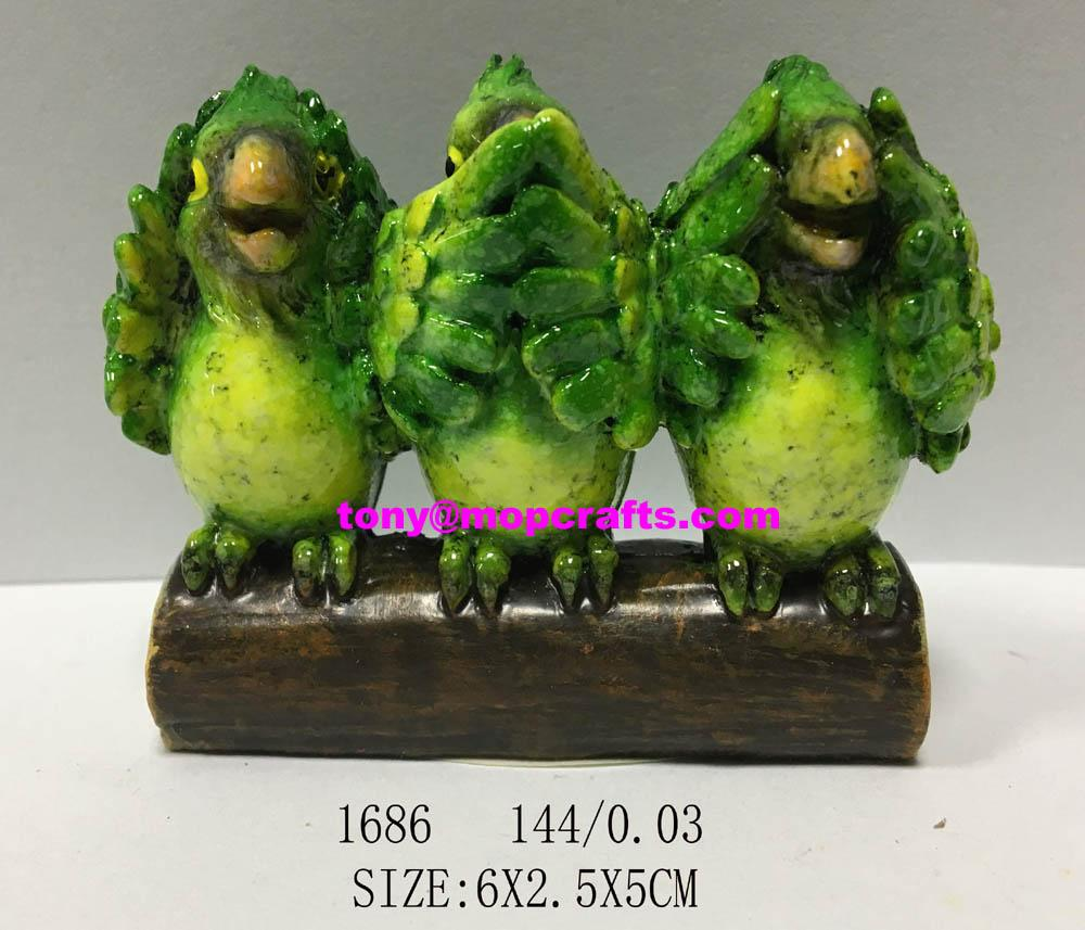 Resin green standing parrot on the wood