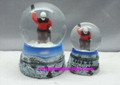 Polyresin skating snowman of snow globe