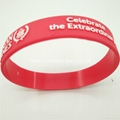 Red silicone bracelet / wristband with embossed logo