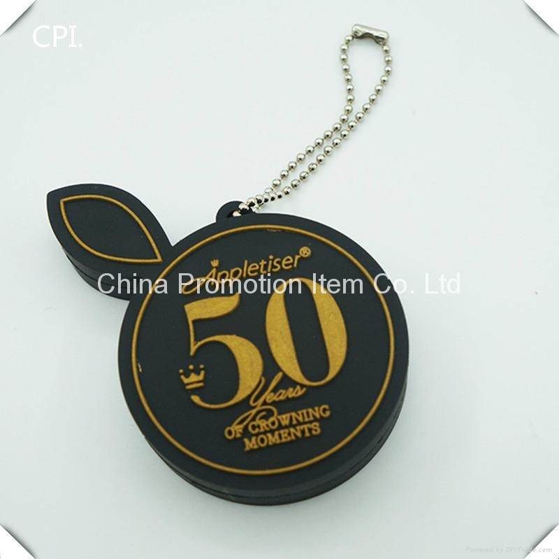 Cute black round usb flash drive with gold embossed logo 1