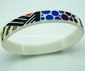 White silicone bracelet with oil filled logo