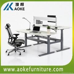 motorized sitting and standing workstation
