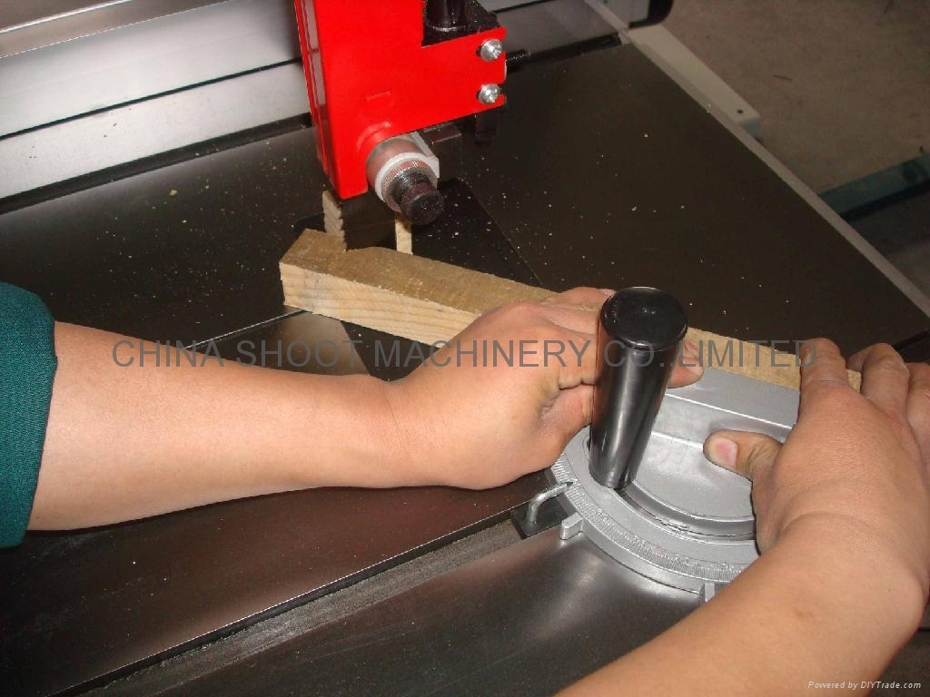 One of our machinists sawing wood for test machine