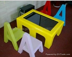 Children touch interactive teaching table